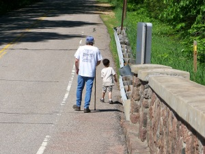 My brother Loren and son Sam walking along the old County Y bridge in 2008. The new bridge will have safer walking lanes and use the old stone on its facade.