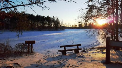 05_A bench near the icy edge of Lake Joanis makes a prime spot for watching a winter sunset